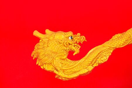 Golden dragon on red wall photo