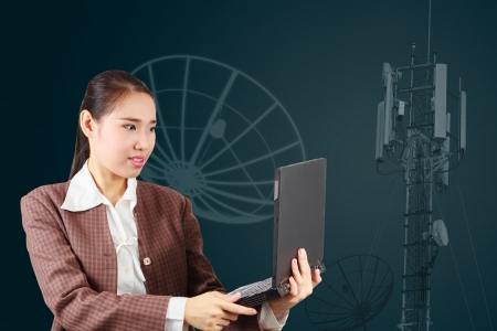 Business woman holding laptop  Satellite communications technology concept  Stock Photo - 17592747