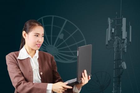 Business woman holding laptop  Satellite communications technology concept Stock Photo - 17592747