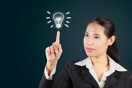 Business woman touch screen with lamp symbol  For business concept Stock Photo - 17888124