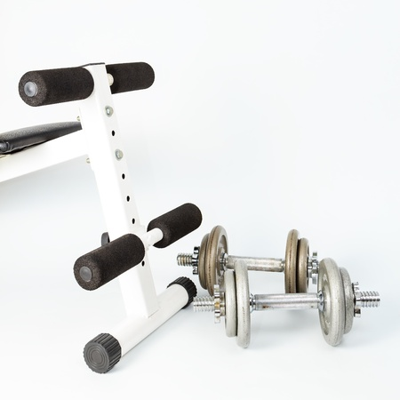 Silver metal dumbbells, one on another isolated on white Stock Photo - 17971320
