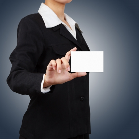 Businessman holding a card. Stock Photo