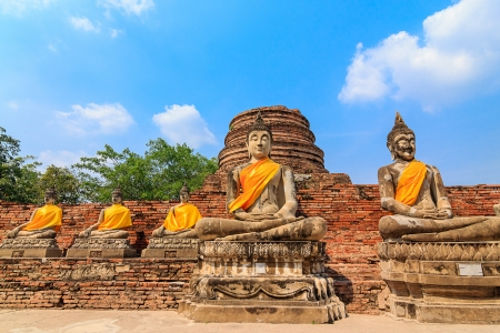 Ancient Buddha statues at Wat Yai Chai Mongkol in Ayutthaya, Thailand