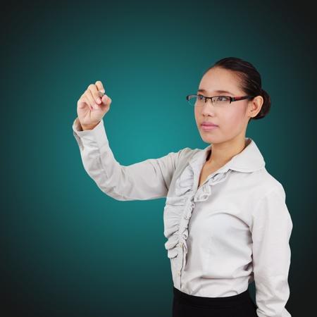 Young women business writing something on the screen  Beautiful Asian women Stock Photo - 18152928