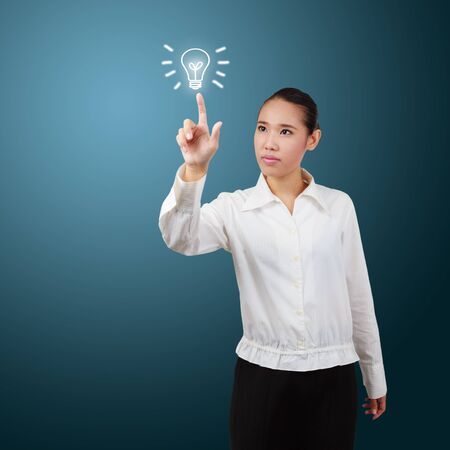 Business woman touch screen with lamp symbol. For business concept. Stock Photo - 18445686