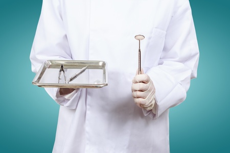 Closeup of dentist hand taking mirror from on of dental tools. Stock Photo - 19186613