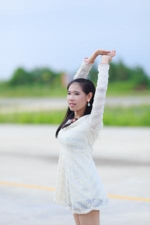 Beautiful Asian woman enjoy nature meadow. Stock Photo - 21304712