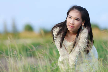 Beautiful Asian woman enjoy nature meadow. photo