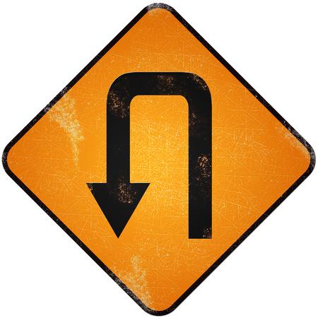 u turn sign: U turn road sign. Damaged yellow metallic road sign with U turn symbol.