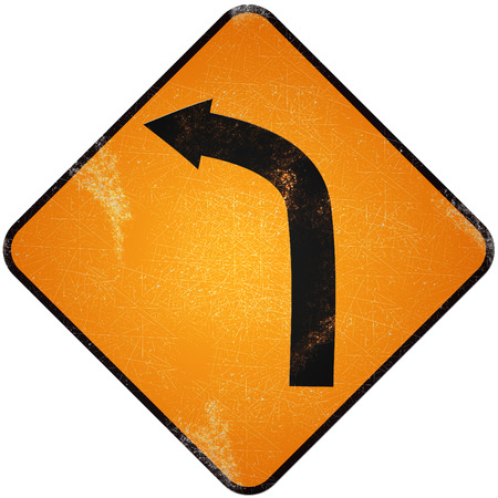 Turn left road sign. Damaged yellow metallic road sign with turn left symbol. photo