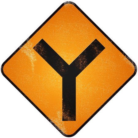 Fork road sign. Damaged yellow metallic road sign with fork symbol.