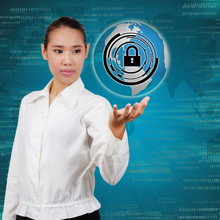 Business woman touching virtual screen of security. Concept of security business Information systems and networks. photo