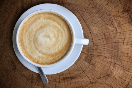 Top view of White ceramic cup of coffee on wood table