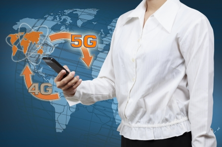 Businessman holding a smartphone. Concept for business communication on the network interface to Internet and world wide web connection on speed 5 generation. Stock Photo
