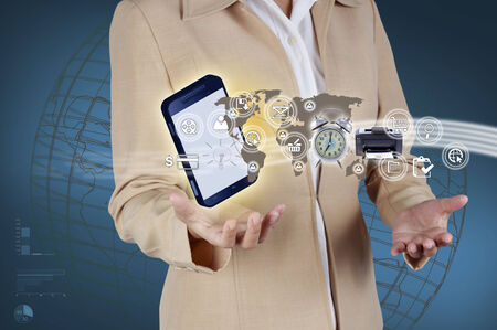 Business woman showing mobile phone and icon web symbol on hand photo