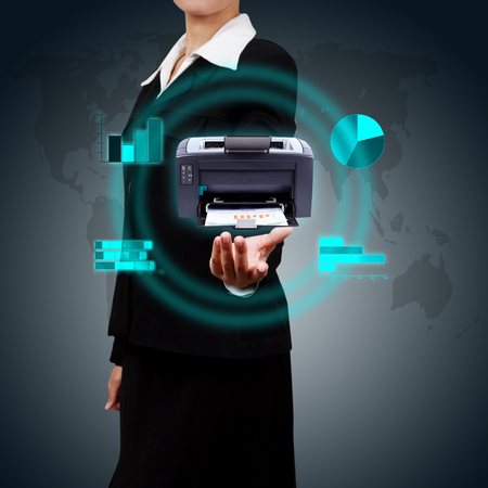 Business Woman showing printer and various graphs concept of business reporting  photo