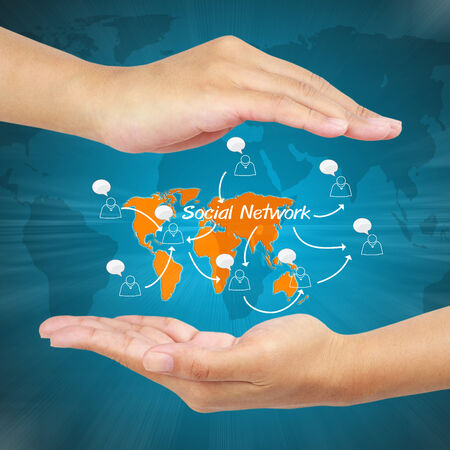Hand of businessman showing social network concept. photo
