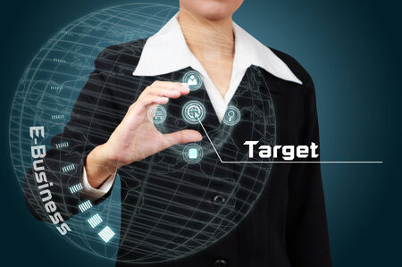 Businessman touching a business target on virtual screen. photo