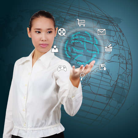 business woman showing a business strategy on virtual screen. Stock Photo - 26321977