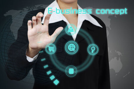 Businessman showing e-business concept on virtual screen. Stock Photo