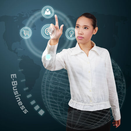 Business woman touching e-business concept on virtual screen. Stock Photo