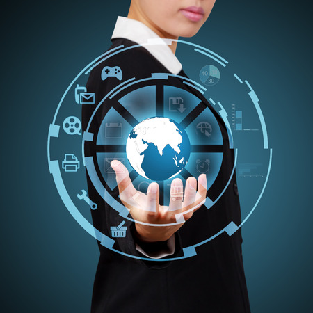 Business woman showing globe and icon application on virtual screen Stock Photo