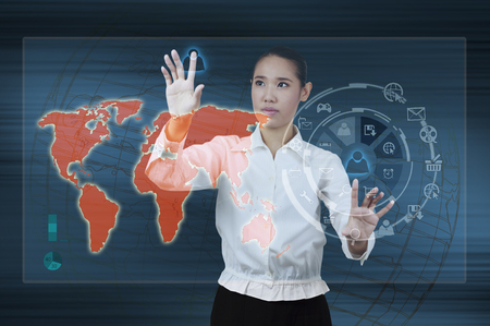 Business woman touching a icon application on virtual screen photo