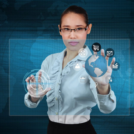 Business woman touching the globe and icon application on virtual screen photo