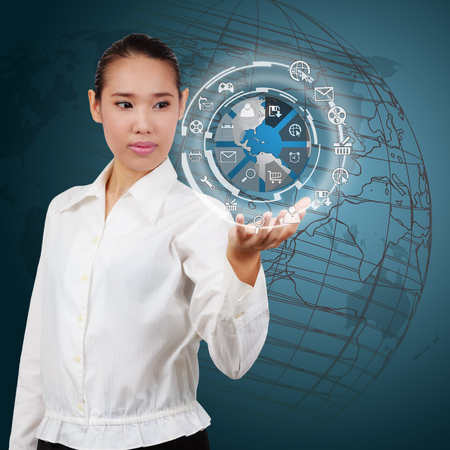 Business woman  showing the globe and icon application on virtual screen photo