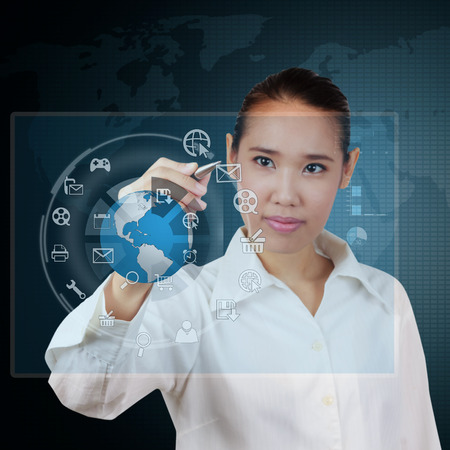 Business woman writing business plan on virtual screen photo