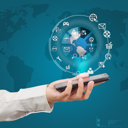 Businessman showing smartphone with globe and icon application on virtual screen photo