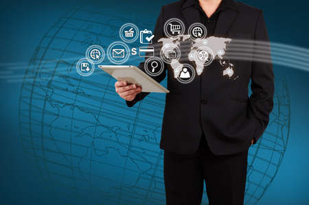 application software: Businessman showing map and icon application on virtual screen Stock Photo
