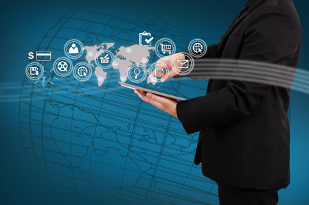 Businessman showing map and icon application on virtual screen  Concept of online business