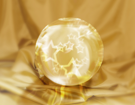 magic star crystal ball on a gold fabric background