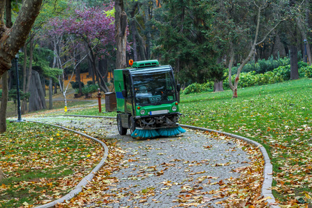 Street sweeper removing leaves in Gulhane Public Park, Istanbul