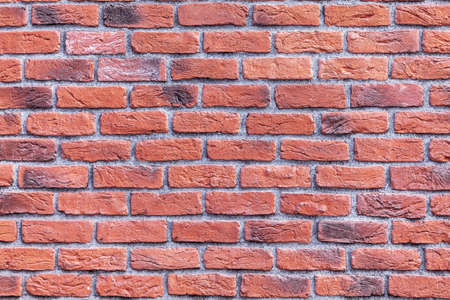 Close up photo of a red brick wall.