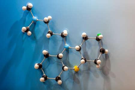 A molecule model on light blue background