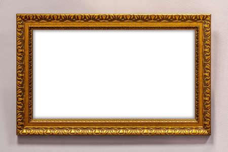 Golden picture frame on wall