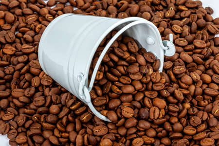 white bucket in lot of coffee beans
