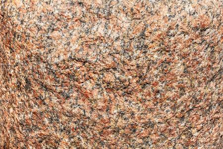 rough pink and gray feldspar granite rock surface