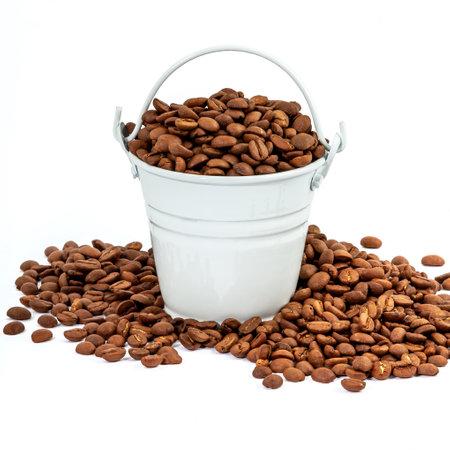 white tiny bucket full of coffee beans