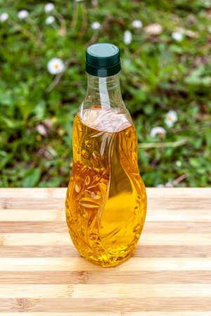 olive oil in olive embossed glass bottle Banque d'images