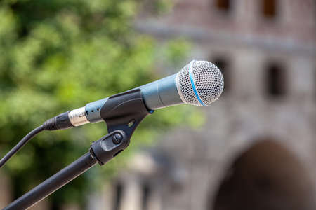 Microphone on abstract blurred meeting area