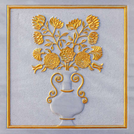 Flowers and vase carved from white marble relief with golden foil Banque d'images