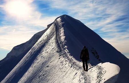 monch: Alpinist on Monch Peak Berner Oberland Switzerland