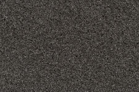 unpressed: Photo of a background of black foam rubber
