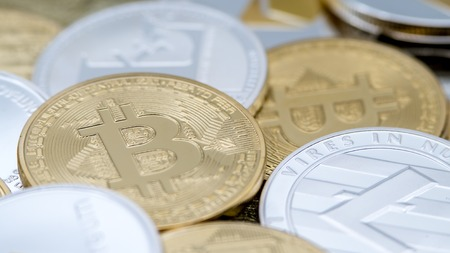 Diferent physical metal currency background. New worldwide virtual internet money. Digital coin in cyberspace, cryptocurrency. Good investment future of online payment Stock Photo