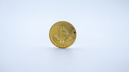 Physical metal golden Bitcoin currency on white background. New worldwide virtual internet money. Digital coin in cyberspace, cryptocurrency gold BTC. Good investment future of online payment Stock Photo