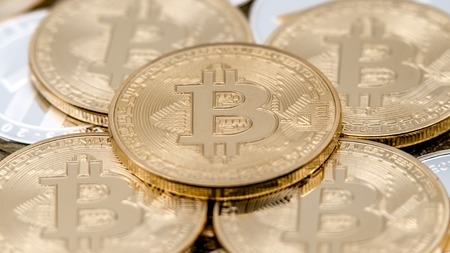 Physical metal golden Bitcoin currency over others coins. New worldwide virtual internet money. Digital coin cyberspace cryptocurrency gold BTC. Good investment future online payment