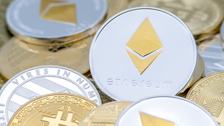 Physical metal silver Ethereum currency over others coins. Worldwide virtual internet money. Digital Etherum coin cyberspace, cryptocurrency ETH. Good investment future online payment